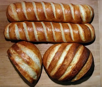 Photo of four loaves of bread